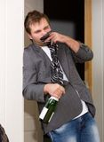 Funny drunk guy. With a bottle of  vine Stock Images