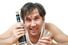 Funny drunk man with bottle of vodka and glass closeup Royalty Free Stock Photos