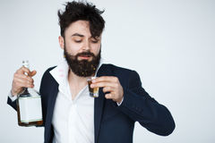 Funny drunk man holding a whiskey bottle Stock Photos