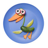 Funny duck made of vegetables on plate Stock Image