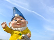 Funny dwarf with a yellow jacket and blue hat Stock Images