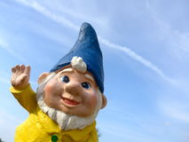 Funny dwarf with a yellow jacket and blue hat Royalty Free Stock Photography