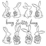 Funny Easter bunnies with festive decorative eggs. Vector illustration. Outline drawing, Easter collection  element. Easter set with  funny rabbits. Black and Stock Photography