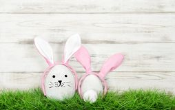 Funny Easter bunnies green grass Eggs decoration. Funny Easter bunnies in green grass. Eggs decoration Royalty Free Stock Photo