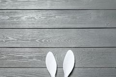 Funny Easter bunny ears on wooden background, top view. With space for text royalty free stock photography