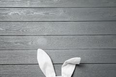 Funny Easter bunny ears on wooden background, top view royalty free stock photo