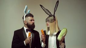 Funny easter bunny. Happy funny easter couple with carrot. Family celebrate Easter. Easter rabbits. Couple with bunny
