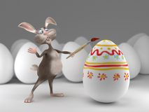 Funny Easter Bunny paints on eggs. Holiday  illustration Stock Photo