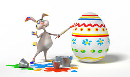 Funny Easter Bunny paints on eggs on white background. Holiday  illustration Royalty Free Stock Images
