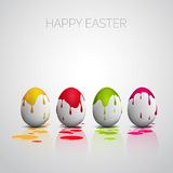Funny Easter eggs with color splatters Stock Photos