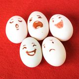 Funny Easter eggs with different emotions on his face Stock Image
