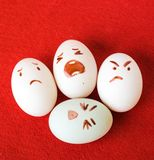 Funny Easter eggs with different emotions on his face Stock Photography