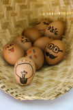 Funny easter eggs, Painted eggs on basket Royalty Free Stock Image