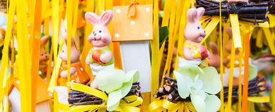 Funny Easter rabbits figurines in a market Royalty Free Stock Photo