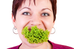 Funny eating salad Stock Photography