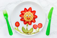 Funny edible flower from strawberry kiwi and waffle Royalty Free Stock Image