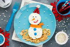 Funny edible snowman for breakfast - Christmas and New Year fun Stock Image