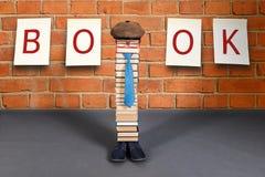 Funny education idea, man teacher on book Fair. Funny education idea, unusual man teacher on book Fair. Children joke stock photos