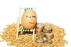 Funny egg and euro coins with seeds Royalty Free Stock Photo