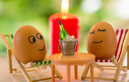 Funny eggs on a beach chair relaxing Stock Photo