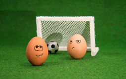 Funny eggs and football Stock Photos
