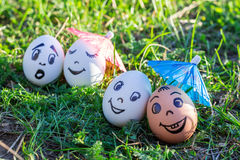 Funny eggs imitate smiling mixed couple and indignant white coup Royalty Free Stock Photos