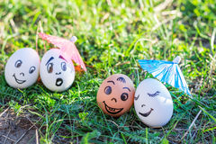 Funny eggs imitating happy mixed couple and indignant white coup Stock Images