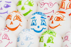Funny eggs with painted eyes and mouth Royalty Free Stock Photos