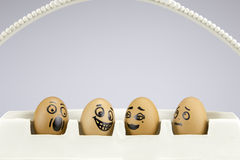 Funny eggs with painted faces Stock Photography