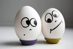 Funny funny eggs. two eggs the right Stock Photography