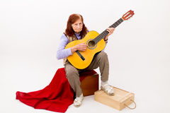 Funny elderly lady playing acoustic guitar Royalty Free Stock Photo