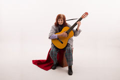 Funny elderly lady playing acoustic guitar Stock Images