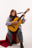 Funny elderly lady playing acoustic guitar Stock Photo