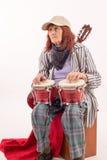 Funny elderly lady playing bongo Stock Images