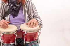 Funny elderly lady playing bongo Stock Photo