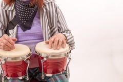 Funny elderly lady playing bongo Stock Photo