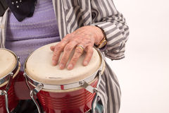 Funny elderly lady playing bongo Royalty Free Stock Photos