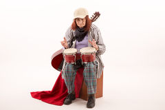Funny elderly lady playing bongo Stock Photography