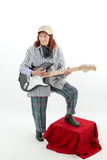 Funny elderly lady playing electric guitar Royalty Free Stock Photo