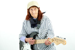 Funny elderly lady playing electric guitar Royalty Free Stock Images