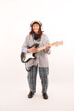 Funny elderly lady playing electric guitar Stock Photography
