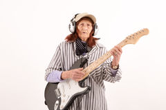 Funny elderly lady playing electric guitar Royalty Free Stock Photos