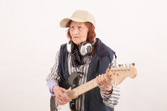 Funny elderly lady playing electric guitar Stock Photos