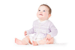 Funny elegant baby girl playing with pearls Stock Photos
