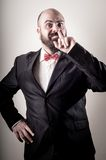 Funny elegant bearded man with finger in the nose Stock Photos