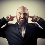 Funny elegant bearded man fingers in the ears Royalty Free Stock Photo