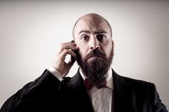 Funny elegant bearded man on the phone Royalty Free Stock Images