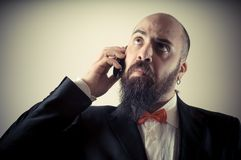 Funny elegant bearded man on the phone Stock Images
