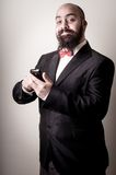 Funny elegant bearded man on the phone Royalty Free Stock Photography