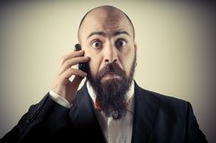 Funny elegant bearded man on the phone Stock Photography